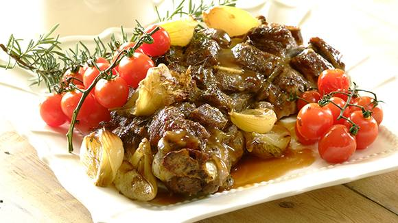 Roast Shoulder of Lamb with Garlic and Tomatoes
