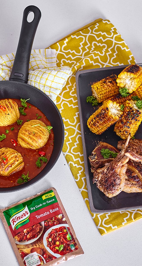 Lamb Chops with Hasselback Potatoes and a Tomato Parmesan Sauce