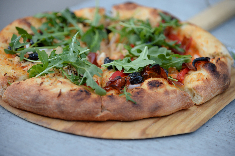 Pizza de rúcula, casera y exquisita