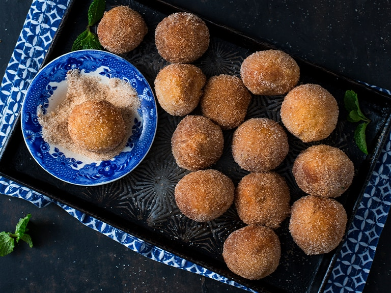 Amagwinya (Koeksisters or Doughnuts) With Caramel Glaze Coconut & Cinnamon Dust